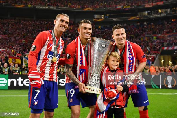 Antoine Griezmann Lucas Hernandez and Kevin Gameiro of Atletico Madrid celebrate victory with the Europa League trophy after the UEFA Europa League...