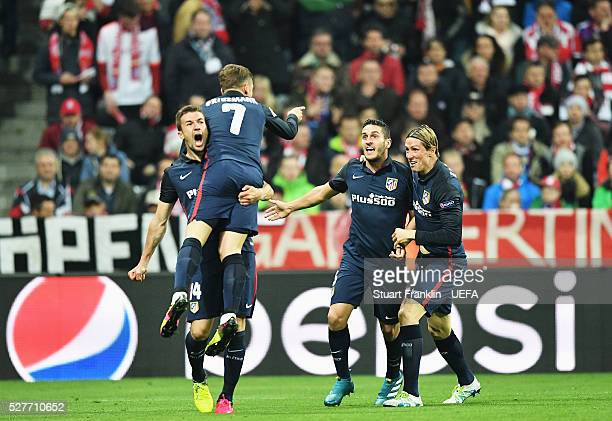 Antoine Griezmann of Athletico celebrates scoring his goal during the UEFA Champions League Semi Final second leg match between FC Bayern Muenchen...