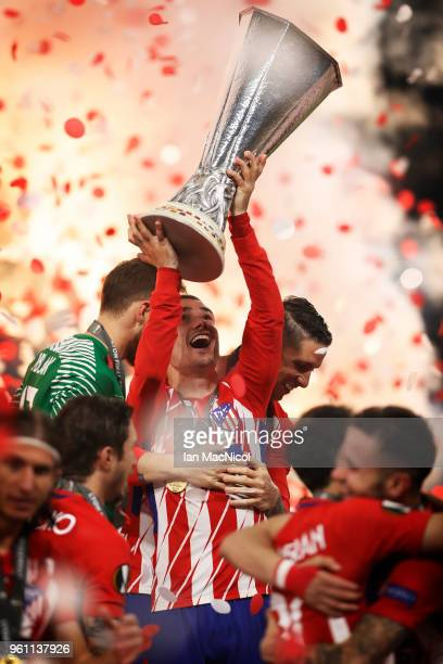 Antoine Griezmann of Athletico Madrid holds the trophy during the UEFA Europa League Final between Olympique de Marseille and Club Atletico de Madrid...