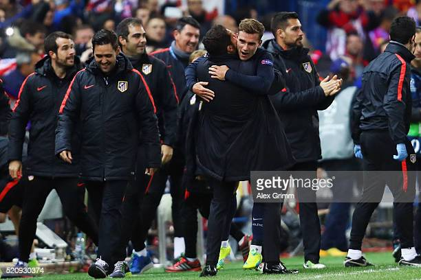 Antoine Griezmann of Atletico celebrates his team's second goal with head coach Diego Simeone during the UEFA Champions League Quarter Final Second...
