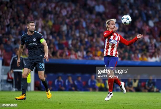 Antoine Griezmann of Atletico de Madrid and Gary Cahill of Chelsea in action during the UEFA Champions League Group C match between Atletico Madrid...