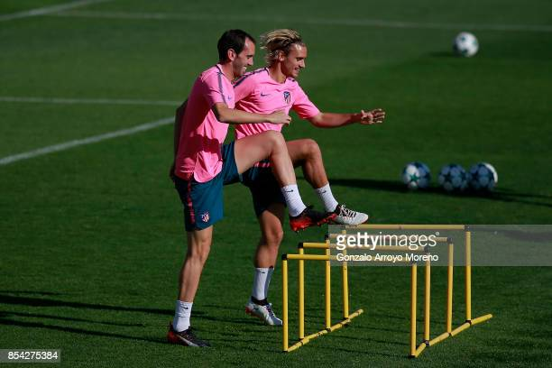 Antoine Griezmann of Atletico de Madrid and his teammate Diego Godin excersise during a training session on the eve of the UEFA Champions League...