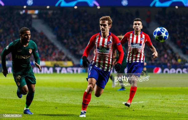 Antoine Griezmann of Atletico de Madrid and Samuel Grandsir of Monaco battle for the ball during the Group A match of the UEFA Champions League...