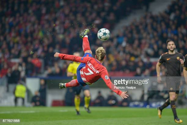 Antoine Griezmann of Atletico de Madrid attemps an overhead kick to convert the first goal during a match between Atletico Madrid and AS Roma as part...