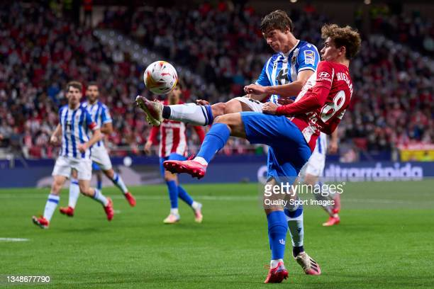 Antoine Griezmann of Atletico de Madrid battle for the ball with Robin Le Normand of Real Sociedad during the La Liga Santander match between Club...