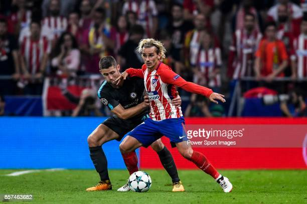 Antoine Griezmann of Atletico de Madrid battles for the ball with Gary Cahill of Chelsea FC during the UEFA Champions League 201718 match between...