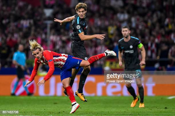 Antoine Griezmann of Atletico de Madrid battles for the ball with Marcos Alonso of Chelsea FC during the UEFA Champions League 201718 match between...