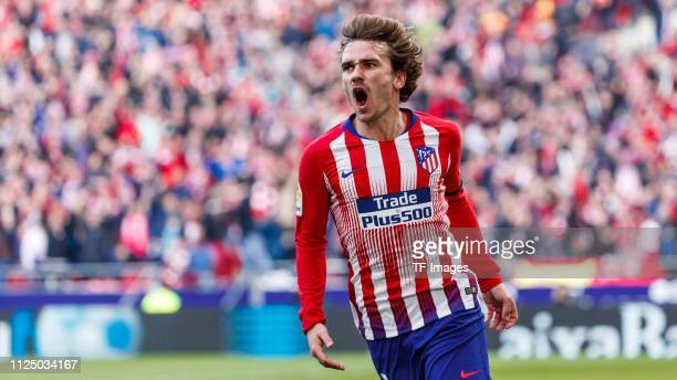 Antoine Griezmann of Atletico de Madrid celebrates after scoring his team`s first goal 11 battle for the ball during La Liga match between Atletico...