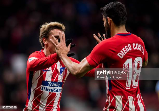 Antoine Griezmann of Atletico de Madrid celebrates his fourth goal with teammate Diego Costa during the La Liga 201718 match between Atletico de...