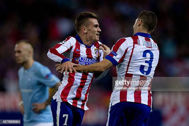 Antoine Griezmann of Atletico de Madrid celebrates scoring their second goal with team mate Guilherme Madalena Siqueira during the UEFA Champions...