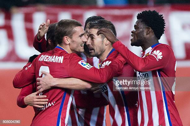 Antoine Griezmann of Atletico de Madrid celebrates scoring their third goal with teammates Gabi Fernandez and Thomas Teye Partey during the Copa del...