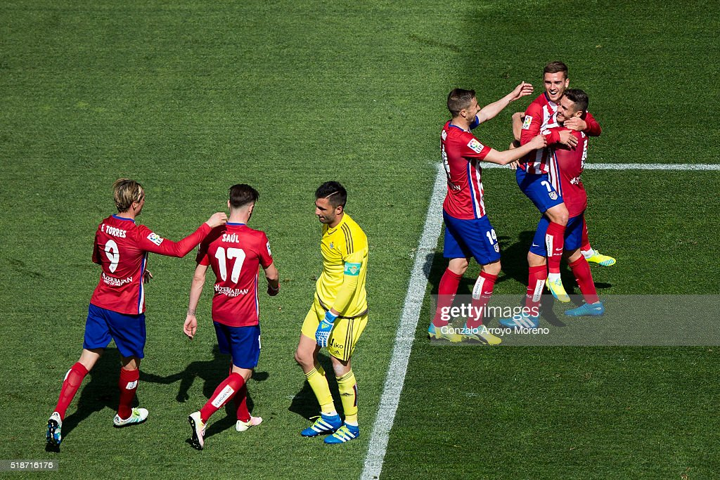 Antoine Griezmann (2R) of Atletico de Madrid celebrates scoring their second goal with teammates Koke (R), Gabi Fernandez (3dR), Fernando Torres (L) and Saul Niguez (2ndL) as goalkeeper Antonio Adan (3dL) of Real Betis Balompie reacts during the La Liga match between Club Atletico de Madrid and Real Betis Balompie at Vicente Calderon Stadium on April 2, 2016 in Madrid, Spain.