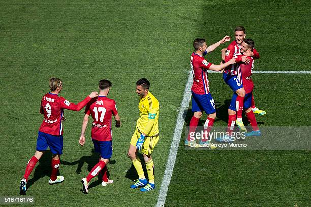 Antoine Griezmann of Atletico de Madrid celebrates scoring their second goal with teammates Koke Gabi Fernandez Fernando Torres and Saul Niguez as...