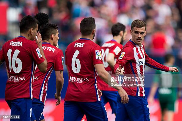 Antoine Griezmann of Atletico de Madrid celebrates scoring their fourth goal with teammate Koke during the La Liga match between Club Atletico de...