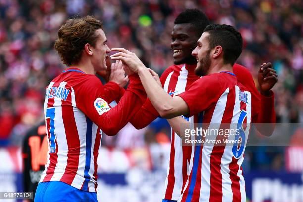 Antoine Griezmann of Atletico de Madrid celebrates scoring their third goal with teammates Thomas Teye Partey and Koke during the La Liga match...