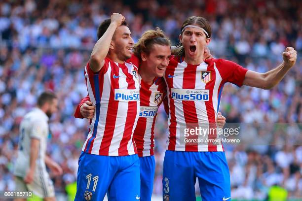 Antoine Griezmann of Atletico de Madrid celebrates scoring their opening goal with teammates Angel Martin Correa and Filipe Luis during the La Liga...