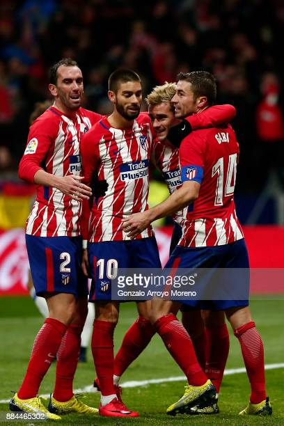 Antoine Griezmann of Atletico de Madrid celebrates scoring their second goal with teammates Gabi Fernandez Yannick Carrasco and Diego Godin during...