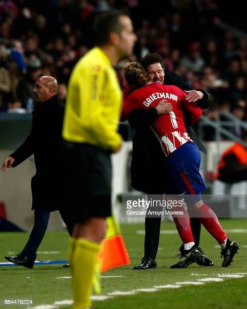 Antoine Griezmann of Atletico de Madrid celebrates scoring their second goal with his coach Diego Pablo Simeone as he leaves the pitch during the La...