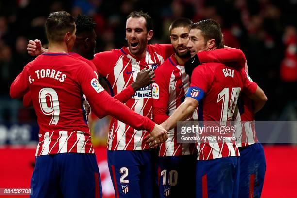Antoine Griezmann of Atletico de Madrid celebrates scoring their second goal with teammates Gabi Fernandez Yannick Carrasco Diego Godin Thomas Teye...
