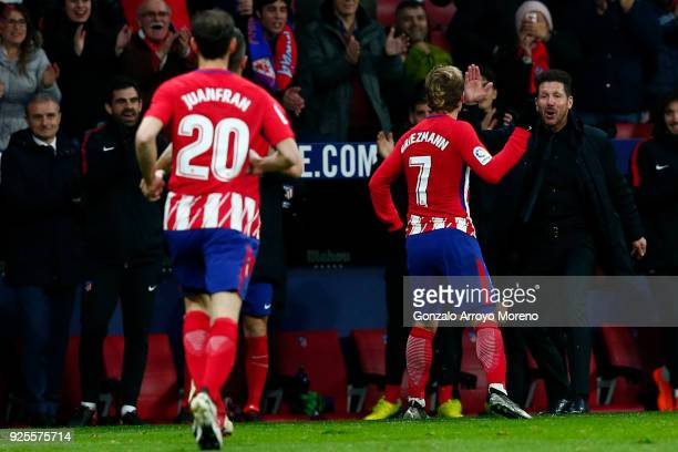 Antoine Griezmann of Atletico de Madrid celebrates scoring their second goal with his coach Diego Pablo Simeone during the La Liga match between Club...