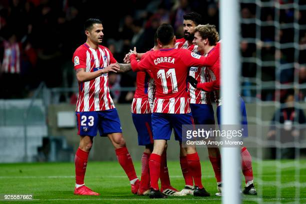 Antoine Griezmann of Atletico de Madrid celebrates scoring their fourth goal with teammates Diego Costa Angel Martin Correa and Victor Machin alias...