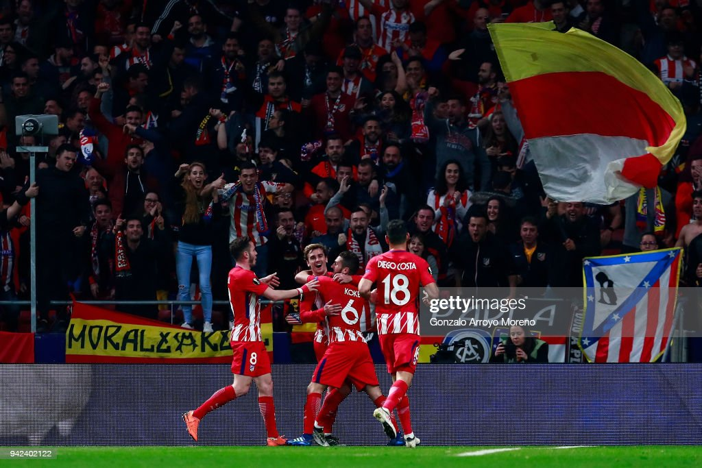 Antoine Griezmann (2nd L) of Atletico de Madrid celebrates scoring their second goal with teammates Saul Niguez (L), Koke (2nd R) and Diego Costa (R) during the UEFA Europa League quarter final leg one match between Club Atletico Madrid and Sporting CP at Wanda Metropolitano stadium on April 5, 2018 in Madrid, Spain.