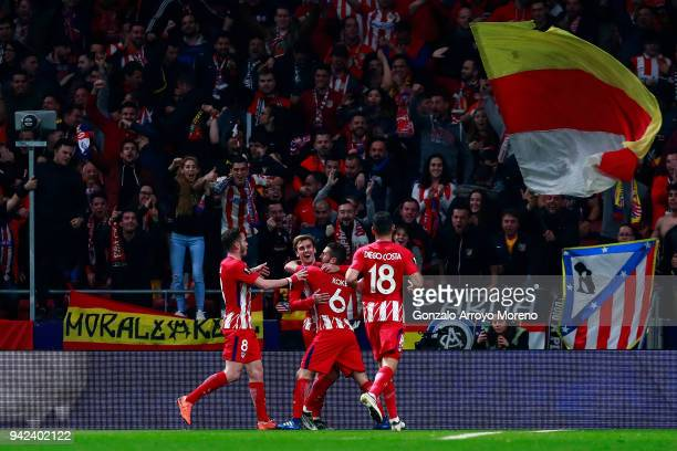 Antoine Griezmann of Atletico de Madrid celebrates scoring their second goal with teammates Saul Niguez Koke and Diego Costa during the UEFA Europa...