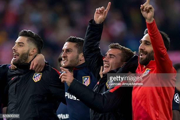 Antoine Griezmann of Atletico de Madrid celebrates their victory with teammates Yannick Carrasco Koke and Jesus Gamez during the UEFA Champions...