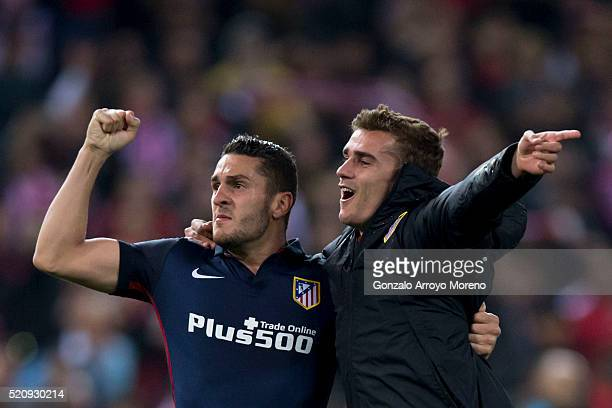 Antoine Griezmann of Atletico de Madrid celebrates their victory with teammate Koke during the UEFA Champions League quarter final second leg match...