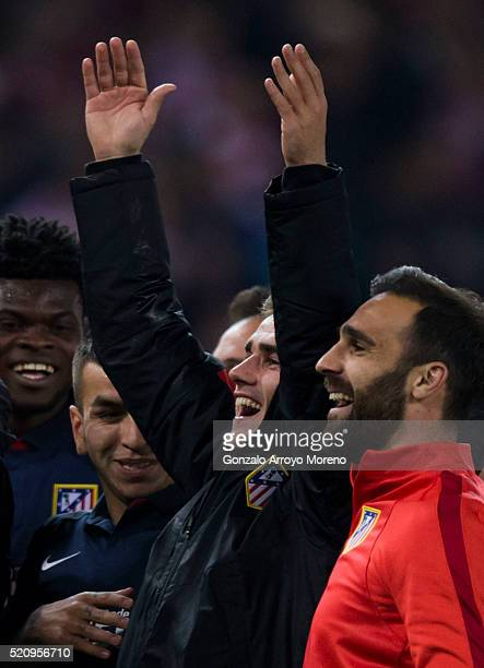 Antoine Griezmann of Atletico de Madrid celebrates their victory with teammates Jesus Gamez Angel Martin Correa and Thomas Teye Partey during the...