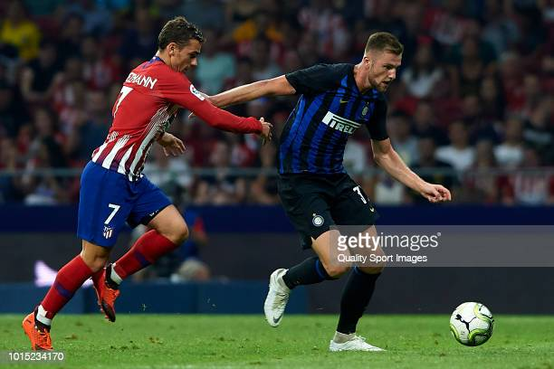 Antoine Griezmann of Atletico de Madrid competes for the ball with Milan Skriniar of FC Internazionale during the International Champions Cup 2018...