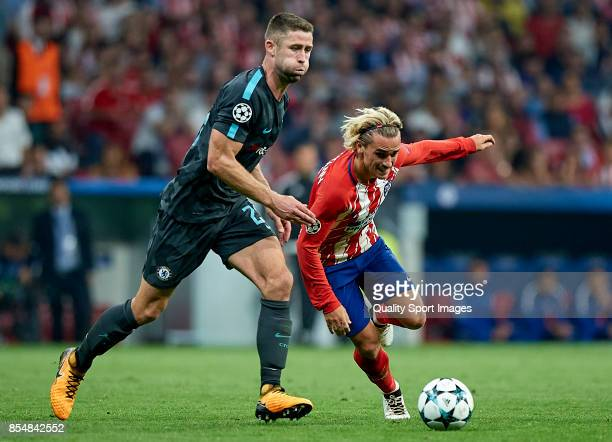 Antoine Griezmann of Atletico de Madrid competes for the ball with Gary Cahill of Chelsea during the UEFA Champions League group C match between...