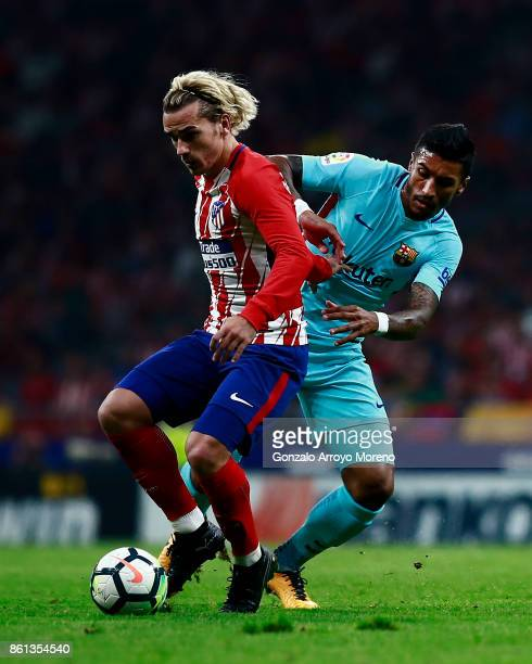 Antoine Griezmann of Atletico de Madrid competes for the ball with Jose Paulo Becerra alias Paulinho of FC Barcelona during the La Liga match between...