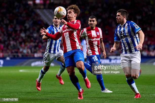 Antoine Griezmann of Atletico de Madrid controls a ball during the La Liga Santander match between Club Atletico de Madrid and Real Sociedad at...