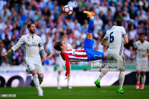 Antoine Griezmann of Atletico de Madrid does a scissor kick during the La Liga match between Real Madrid CF and Club Atletico de Madrid at Estadio...