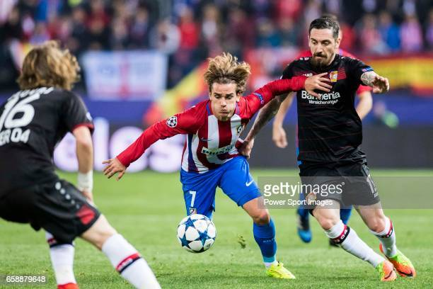 Antoine Griezmann of Atletico de Madrid fights for the ball with Roberto Hilbert of Bayer 04 Leverkusen during their 201617 UEFA Champions League...
