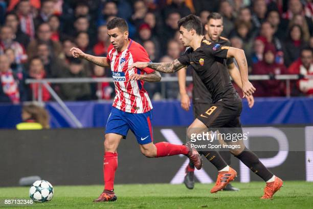 Antoine Griezmann of Atletico de Madrid flights with Aleksandar Kolarov of AS Roma for the ball during the UEFA Champions League 201718 match between...