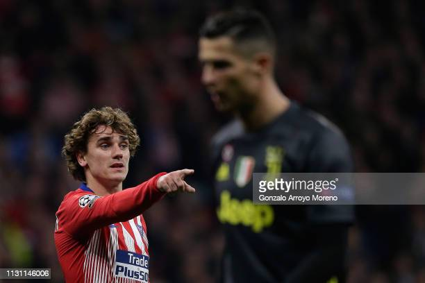 Antoine Griezmann of Atletico de Madrid gives instructions to his teammates behind Cristiano Ronaldo of Juventus during the UEFA Champions League...