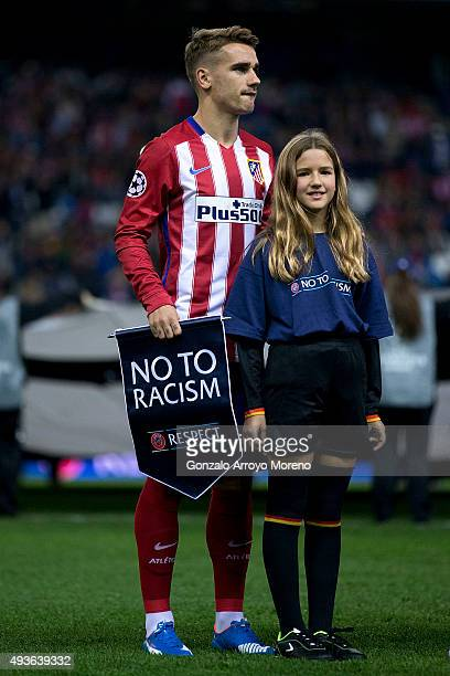 Antoine Griezmann of Atletico de Madrid holds the UEFA No To Racism pennant behind one of the escort kids prior to start the UEFA Champions League...