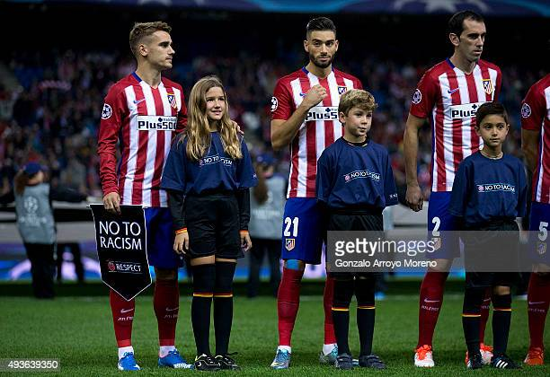 Antoine Griezmann of Atletico de Madrid holds the UEFA No To Racism pennant close to his teammates Yannick Carrasco and Juan Francisco Torres alias...