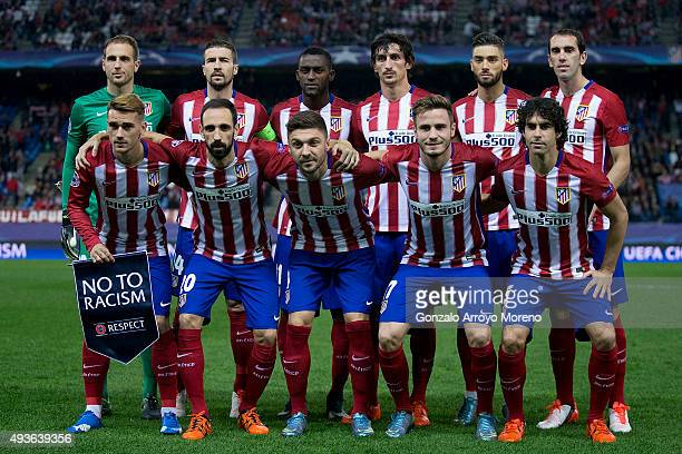 Antoine Griezmann of Atletico de Madrid holds the UEFA No To Racism pennant as a he pose with his teammates for the lineup piocture prior to start...