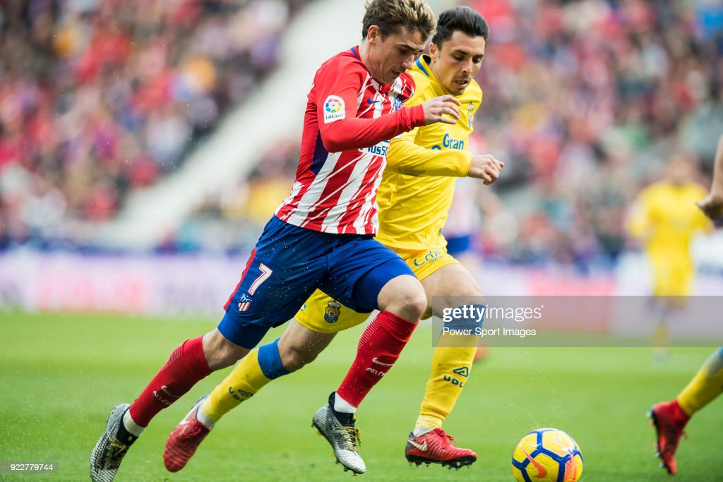 Antoine Griezmann (L) of Atletico de Madrid is tackled by Joaquin Navarro Jimenez, Ximo, of UD Las Palmas during the La Liga 2017-18 match between Atletico de Madrid and UD Las Palmas at Wanda Metropolitano on January 28 2018 in Madrid, Spain.