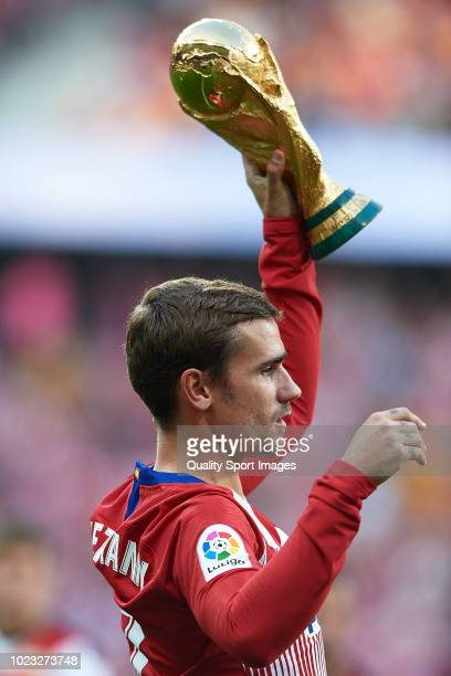 Antoine Griezmann of Atletico de Madrid poses with FIFA World Cup 2018 trophy prior to the La Liga match between Club Atletico de Madrid and Rayo...