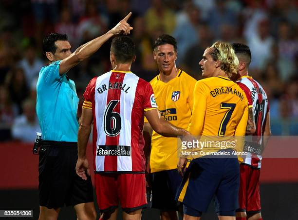 Antoine Griezmann of Atletico de Madrid reacts after being shown a straight red card by Refere Juan Martinez Munuera during the La Liga match between...