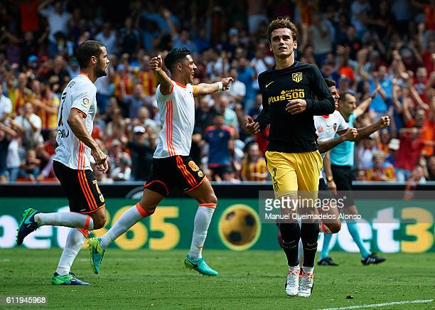 Antoine Griezmann of Atletico de Madrid reacts after failing a score a penalty during the La Liga match between Valencia CF and Atletico de Madrid at...