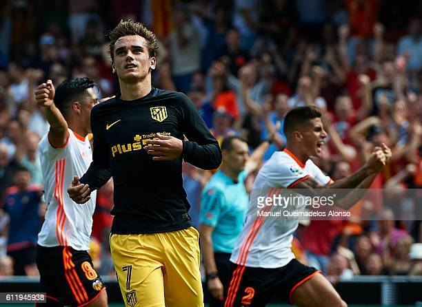 Antoine Griezmann of Atletico de Madrid reacts after failing to score a penalty during the La Liga match between Valencia CF and Atletico de Madrid...