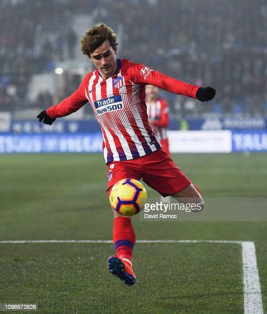 Antoine Griezmann of Atletico de Madrid runs with the ball during the La Liga match between SD Huesca and Club Atletico de Madrid at Estadio El...