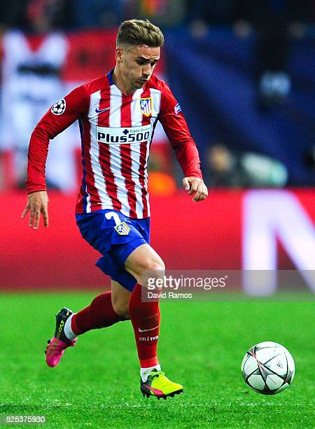 Antoine Griezmann of Atletico de Madrid runs with the ball during the UEFA Champions League semi final first leg match between Club Atletico de...