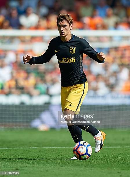 Antoine Griezmann of Atletico de Madrid runs with the ball during the La Liga match between Valencia CF and Atletico de Madrid at Mestalla Stadium on...