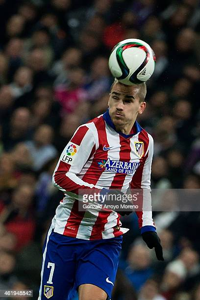 Antoine Griezmann of Atletico de Madrid saves on a header during the Copa del Rey Round of 16 second leg match between Real Madrid CF and Club...